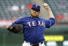 Texas Rangers starting pitcher Robbie Ross delivers to the Seattle Mariners in the first inning of a baseball game, Thursday, Sept. 4, 2014, in Arlington, Texas. (AP Photo/Tony Gutierrez)
