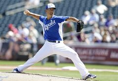 Kansas City Royals starting pitcher Jeremy Guthrie throw against the Colorado Rockies during the first inning of a spring training baseball game Tuesday, March 19, 2013, in Surprise, Ariz. (AP Photo/Gregory Bull)