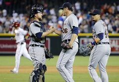 Detroit Tigers catcher Bryan Holaday, left, greets closer Joe Nathan (36) after a baseball game against the Arizona Diamondbacks, Monday, July 21, 2014, in Phoenix. The Tigers won 4-3. At right is Tigers' Victor Martinez. (AP Photo/Matt York)
