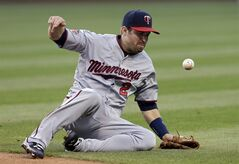 Minnesota Twins second baseman Brian Dozier can't get to a ball hit by Cleveland Indians' David Murphy that goes for a single in the third inning of a baseball game, Tuesday, May 6, 2014, in Cleveland. (AP Photo/Mark Duncan)