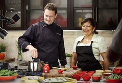 Royal Ontario Museum Chef Corbin Tomaszeski cooks alongside Rozanne Persad, owner of Curry & Roti Restaurant in Scarborough, Ont. in the