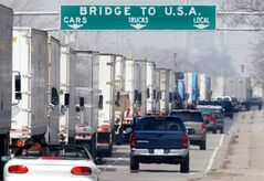 Three-hour delays snarl truck traffic along Huron Church Road in Windsor, Ont., Wednesday, April 2, 2003. The Sept. 11 attacks created a ripple effect of enhanced security, procedural changes and weariness amongst travellers, especially at the Windsor-Detroit crossing — one of the busiest in North America. THE CANADIAN PRESS/Jason Kryk