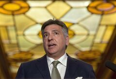 Ontario Finance Minister Charles Sousa is pictured in Toronto on April 15, 2014. THE CANADIAN PRESS/Darren Calabrese