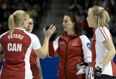 Team Canada's Laine Peters, left, Jessica Mair, 2nd left, skip Heather Nedohin and Beth Iskiw, right celebrate after defeating British Columbia in the page playoff curling action at the Scotties Tournament of Hearts Saturday in Kingston, Ont.