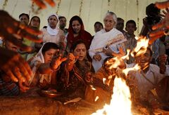 Supporters of Indian yoga guru Baba Ramdev perform a yagya, a religious Hindu ritual of prayer using fire, for the health of Ramdev at his ashram in Haridwar, India, Friday, June 10, 2011. Ramdev has continued his hunger strike for a seventh day despite doctors advising hospitalization because of loss of weight and dehydration. Ramdev's protest campaign is part of a public push to demand government accountability after a series of corruption scandals such as improper telecoms licensing, illegal land acquisitions and irregularities in staging last year's Commonwealth Games. (AP Photo/Gurinder Osan)