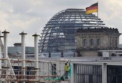 A worker fixes a net on a scaffolding at a construction site in front of the Reichstag building in Berlin, Germany, Thursday, Aug. 14, 2014. The shaky economic recovery in the 18-country eurozone ground to a halt in the second quarter amid fears over the crisis in Ukraine and softer trade and investment. The main reasons behind the flat outcome was a 0.2 percent quarterly decline in Germany, Europe's biggest economy, Eurostat reported Thursday, Aug. 14, 2014. (AP Photo/Ferdinand Ostrop)