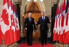 French Prime Minister Jean- Marc Ayrault and Canadian Prime Minister Stephen Harper(left to right) make their way down the Hall of Honour to a joint news conference on Parliament Hill in Ottawa Thursday, March 14, 2013. THE CANADIAN PRESS/ Fred Chartrand