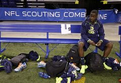 Louisville quarterback Teddy Bridgewater sits on a bench at the NFL football scouting combine in Indianapolis, Sunday, Feb. 23, 2014. Bridgewater did not run drills at the combine. (AP Photo/Michael Conroy)