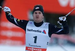 Simeon Hamilton of the United States celebrates his first place in the finish area of the men's sprint competition of the Tour de Ski cross-country World Cup event in Lenzerheide, Switzerland, Tuesday, Dec. 31, 2013. (AP Photo/Keystone, Arno Balzarini)