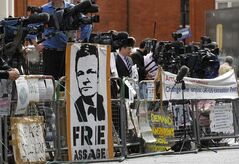 Media gather outside the Ecuadorian Embassy in central London, London, Thursday, Aug. 16, 2012. WikiLeaks founder Julian Assange entered the embassy in June in an attempt to gain political asylum to prevent him from being extradited to Sweden, where he faces allegations of sex crimes, which he denies. (AP Photo/Sang Tan)