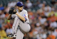 Texas Rangers starting pitcher Scott Baker throws to the Baltimore Orioles in the first inning of a baseball game on Thursday, July 3, 2014, in Baltimore. (AP Photo/Patrick Semansky)