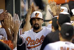Baltimore Orioles' Nick Markakis high-fives teammates in the dugout after hitting a two-run home run in the third inning of a baseball game against the Tampa Bay Rays, Monday, Aug. 25, 2014, in Baltimore. (AP Photo/Patrick Semansky)