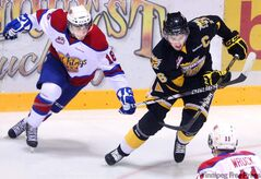 Edmonton Oil Kings' Michael St. Croix, right, picked up two honours this week.