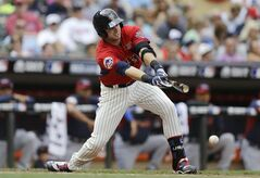United States' Justin O'Conner drives in a run during the third inning of the All-Star Futures baseball game against the World team, Sunday, July 13, 2014, in Minneapolis. (AP Photo/Jeff Roberson)