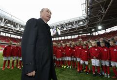 Russian President Vladimir Putin talks to young soccer players during his visit to a new stadium of Spartak Moscow soccer club in Moscow, Wednesday, Aug. 27, 2014. (AP Photo/Sergei Karpukhin, Pool)