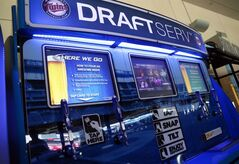 In this July 8, 2014, photo, the newly launched self-service beer kiosks are installed at Target Field, home of the Minnesota Twins and the upcoming All-Star game, in Minneapolis. (AP Photo/Jim Mone)