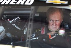 Driver Morgan Shepherd gets ready for practice for Sunday's Sprint Cup Series at New Hampshire Motor Speedway, Saturday, July 12, 2014 in Loudon, NH (AP Photo/Jim Cole)