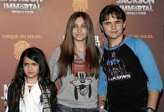 FILE - This Jan. 27, 2012 file photo shows, from left, Blanket Jackson, Paris Jackson, and Prince Michael Jackson at the opening night of the Michael Jackson The Immortal World Tour in Los Angeles. A judge overseeing a guardianship of Michael Jackson's children said Tuesday June 25, 2013, that he was making no changes to oversight of the children after receiving an investigator's report on their well-being and speaking with lawyers for their guardians, Katherine and TJ Jackson. (AP Photo/Dan Steinberg, file)