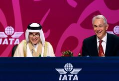 Qatar Airways Chief Executive Officer Akbar Al Baker, left, and International Air Transport Association director Tony Tyler laugh during the the IATA's annual meeting held this year in Doha, Qatar, Monday, June 2, 2014. Tyler says the group will prepare a draft of new recommendations in September to improve global tracking capabilities in the aftermath of the disappearance of Malaysia Airlines Flight 370. (AP Photo/Osama Faisal)