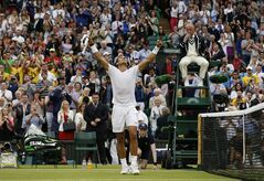 Rafael Nadal of Spain celebrates after defeating Mikhail Kukushkin of Kazakhstan in their men's singles match at the All England Lawn Tennis Championships in Wimbledon, London, Saturday, June 28, 2014. (AP Photo/Ben Curtis)