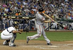 Baltimore Orioles' Nick Hundley hits an RBI single during the 10th inning of a baseball game against the Milwaukee Brewers Monday, May 26, 2014, in Milwaukee. (AP Photo/Morry Gash)
