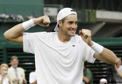 John Isner reacts after winning  the longest match in tennis history.
