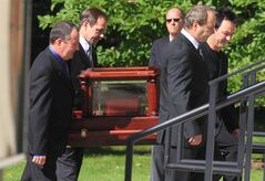 Members of the Rankin family carry the urn of the late Raylene Rankin during a funeral service on October 4, 2012 in Halifax, Nova Scotia. Raylene, who was a member of the acclaimed Cape Breton band The Rankin Family, died after a long fight with cancer at the age of 52. She is survived by her husband and son. THE CANADIAN PRESS/Mike Dembeck.