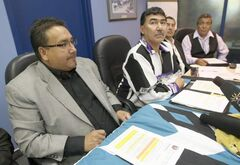 A northern Manitoba First Nation says it has had to detain rowdy persons in a dressing room of a hockey arena because the Mounties won't provide it with keys to their cells. MKO Grand Chief David Harper, left, and Northlands Denesuline First Nation Chief Joe Antsanen.