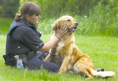 A handler spends time with Max, a sniffer dog whose job at the Winnipeg airport is being eliminated.