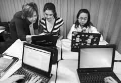 Students receive laptop instruction in Kansas City, Mo., in 2011.