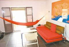 Every room has a mini-lounge with hammock.