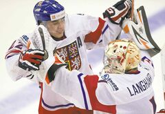 After scoring the winner, Dominik Simon leaps into the arms of Czech Republic goaltender Marek Langhammer.