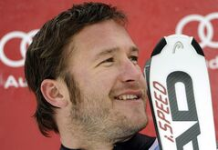 FILE - This Feb. 3, 2012 file photo shows Bode Miller smiling on the podium after finishing second in a World Cup downhill event in Chamonix, France. Miller has announced that he's engaged to professional volleyball player Morgan Beck. The five-time Olympic Alpine skiing medalist tweeted their engagement Monday night, Sept. 17, 2012. (AP Photo/Shinichiro Tanaka)