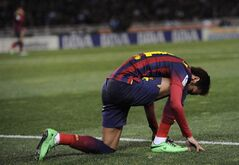 FC Barcelona's Neymar da Silva of Brazil, kneels on the pitch at the end of the match against Real Sociedad, during their Spanish League soccer match, at Anoeta stadium in San Sebastian, Spain, Saturday, Feb. 22, 2014. FC Barcelona lost the match 3-1. (AP Photo/Alvaro Barrientos)