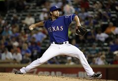 Texas Rangers relief pitcher Spencer Patton works against the Seattle Mariners in the fourth inning of a baseball game, Thursday, Sept. 4, 2014, in Arlington, Texas. The appearance was Patton's major league debut. (AP Photo/Tony Gutierrez)