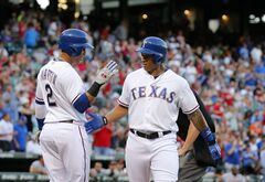 Texas Rangers Leonys Matin (2) congratulates Michael Choice after his home run in the second inning of a baseball game against the Baltimore Orioles Thursday, June 5, 2014, in Arlington, Texas. (AP Photo/Sharon Ellman)
