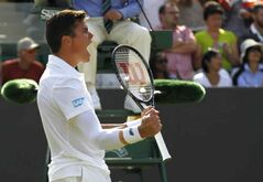 Milos Raonic of Canada celebrates as he defeats Kei Nishikori of Japan in their men's singles match at the All England Lawn Tennis Championships in Wimbledon, London, Tuesday, July 1, 2014.