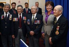 Premier Christy Clark, is joined by Chinese-Canadian Veterans Association members following a ceremony to recognize the formal apology to British Columbia's Chinese-Canadians for historical wrongs by past provincial governments at B.C. Legislature in Victoria, B.C. Thursday May 15, 2014.THE CANADIAN PRESS/Chad Hipolito