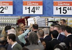 President Barack Obama poses for a selfie photo after speaking at a Walmart store in Mountain View, Calif., Friday, May 9, 2014. Obama announced new steps by companies, local governments and his own administration to deploy solar technology, showcasing steps to combat climate change that don't require consent from a disinclined Congress. (AP Photo/Jeff Chiu)