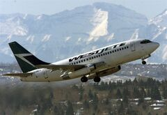 A WestJet plane takes off from the international airport in Calgary, Thursday February 13, 2003. WestJet is reporting its
