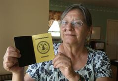 Jeanne Shenandoah, who issues passports for the Haudenosaunee - a confederacy of several Iroquois nations - displays an Onondaga Nation passport at the Onondaga Nation Communications Center in Nedrow, N.Y., near the Onondaga Territory in a July 14, 2010 file photo. The Iroquois nationals are playing for more than wins and losses at the world field lacrosse championships - they're playing for their people's international standing. THE CANADIAN PRESS/AP, The Post-Standard, David Lassman