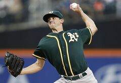 Oakland Athletics Brad Mills delivers in the first inning of an interleague baseball game against the New York Mets in New York, Wednesday, June 25, 2014. The Toronto Blue Jays have claimed Mills off waivers from the A's, bringing the left-handed pitcher back to the team that drafted him. THE CANADIAN PRESS/AP/Kathy Willens