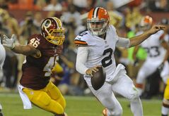 Washington Redskins inside linebacker Will Compton (46) pursues Cleveland Browns quarterback Johnny Manziel (2) during the second half of an NFL preseason football game Monday, Aug. 18, 2014, in Landover, Md. (AP Photo/Richard Lipski)