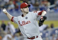 Philadelphia Phillies' Kyle Kendrick delivers a pitch during the first inning of a baseball game against the Miami Marlins, Thursday, July 3, 2014 in Miami. (AP Photo/Wilfredo Lee)