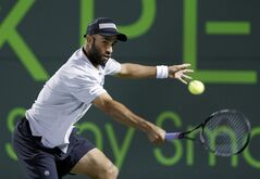James Blake, of the United States, returns a shot from Ryan Harrison, of the United States, during the Sony Open tennis tournament, Wednesday, March 20, 2013, in Key Biscayne, Fla. Blake defeated Harrison 6-2, 6-2. (AP Photo/Wilfredo Lee)