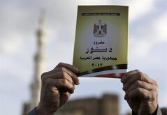 A supporter of Muslim Brotherhood and Egyptian President Mohammed Morsi chants slogans as holds up a copy of Egypt's draft constitution during a demonstration, in Cairo, Egypt, Tuesday, Dec. 11, 2012. Islamists led by Morsi's Muslim Brotherhood group have called a demonstration to back the president's decision to hold a referendum on the new constitution on December 15. Opposition groups have rejected the constitution as undemocratic and want the vote canceled.(AP Photo/Hassan Ammar)