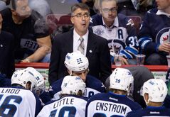 Winnipeg Jets' coach Claude Noel looks up at the clock after calling a time out against the Vancouver Canucks during the third period of an NHL hockey game in Vancouver Thursday.