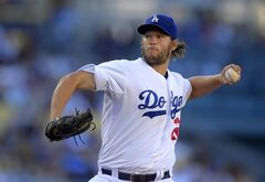 Los Angeles Dodgers starting pitcher Clayton Kershaw throws during the first inning of a baseball game against the Milwaukee Brewers, Saturday, Aug. 16, 2014, in Los Angeles. (AP Photo/Mark J. Terrill)
