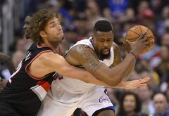 Portland Trail Blazers center Robin Lopez, left, reaches in on Los Angeles Clippers center DeAndre Jordan during the second half of an NBA basketball game, Wednesday, Feb. 12, 2014, in Los Angeles. (AP Photo/Mark J. Terrill)