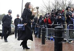 Celebrity chef, Nigella Lawson arrives at Isleworth Crown Court in London, Wednesday, Dec. 4, 2013. Celebrity chef Nigella Lawson could face questions Wednesday about alleged drug use when she appears as a witness at the fraud trial of her former personal assistants. Lawson is due to testify as a prosecution witness against Italian sisters Elisabetta and Francesca Grillo. The pair are accused of living the high life by using credit cards loaned to them by Lawson and her ex-husband Charles Saatchi. (AP Photo/PA, Steve Parsons) UNITED KINGDOM OUT NO SALES NO ARCHIVE